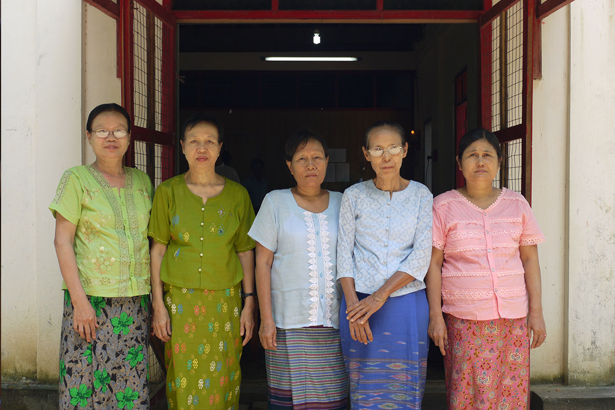 Members of a community savings group, these women are excited to share their knowledge and skills and pool their resources for community development.