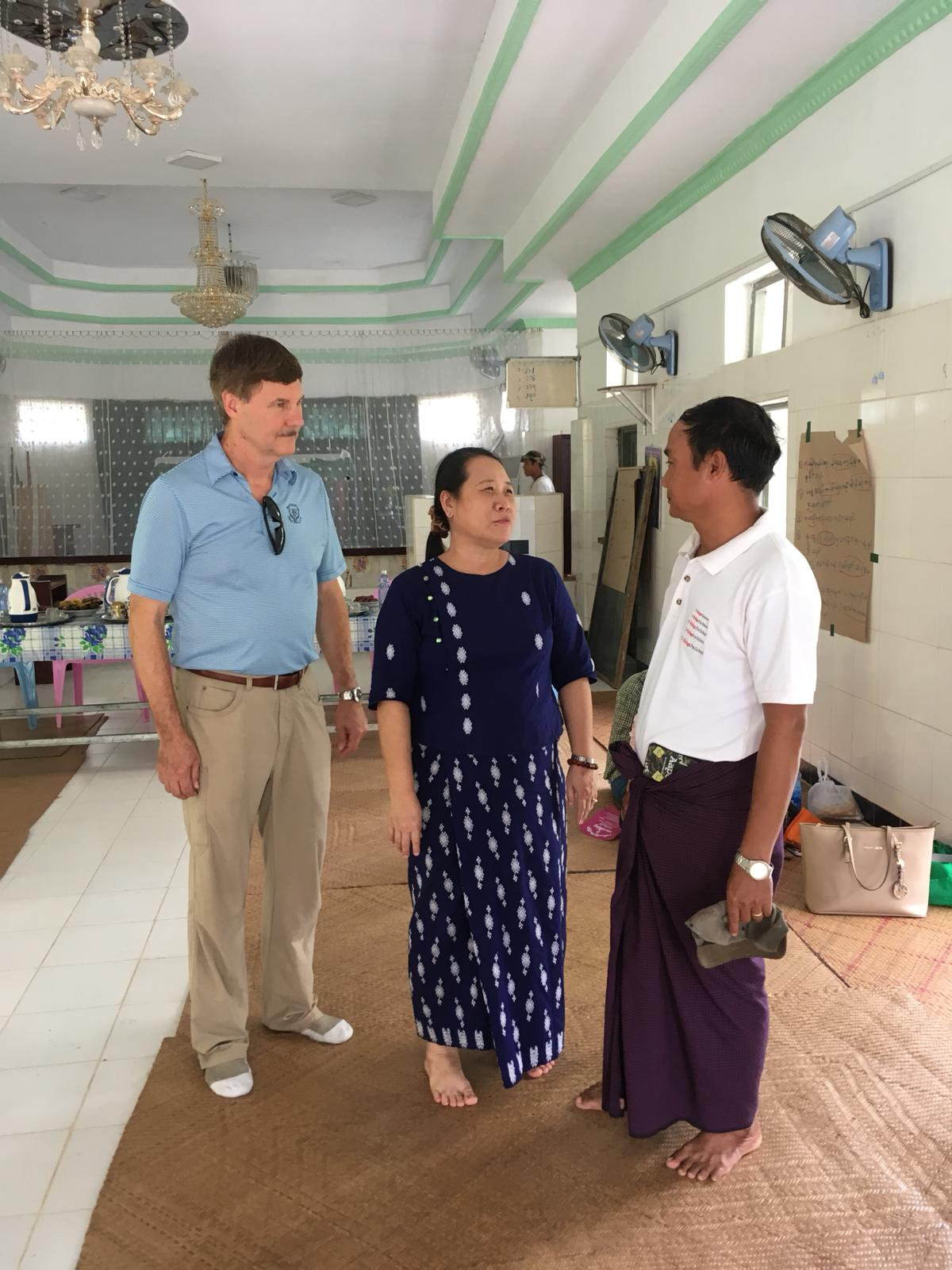 Five Talents Executive Director, Dale Stanton-Hoyle, meets with local program leaders in the Irrawaddy region of Myanmar. Five Talents has worked in Myanmar since 2011 to help impoverished, rural communities learn to save, invest, and build sustainable businesses.