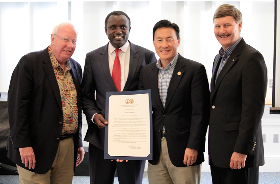 Five Talents Board Chairman, Jim Oakes, and Executive Director, Dale Stanton-Hoyle, receive a resolution from Virginia Delegate Mark Keam with Program Partner, Harun Mutuma.