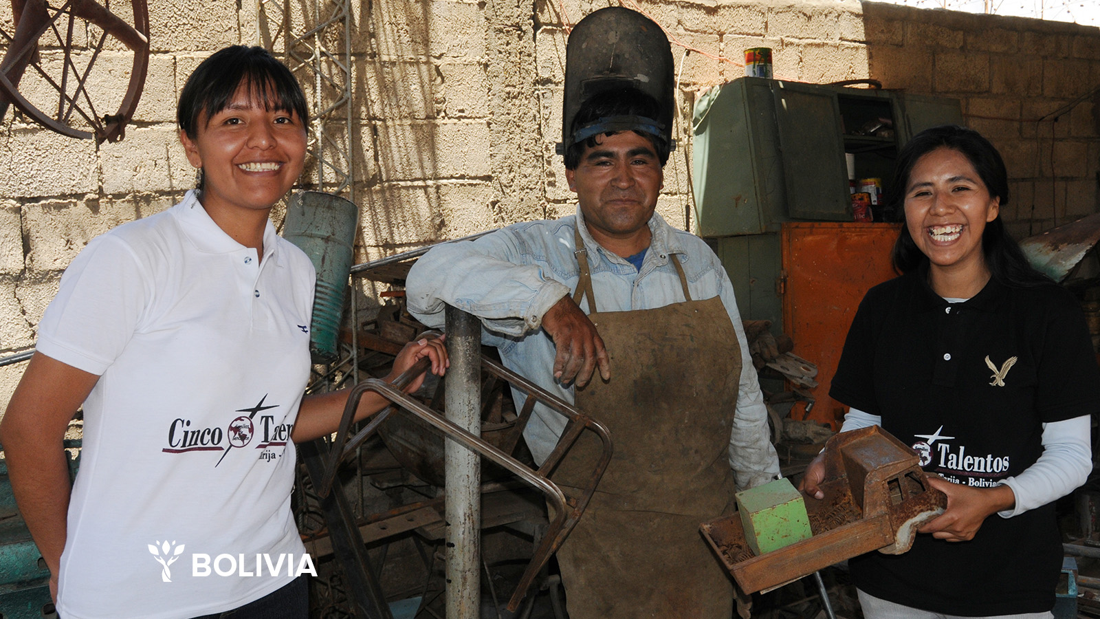 Alejandro is a metal worker in Bolivia. Pictured here with Five Talents leaders Sarah and Eva.