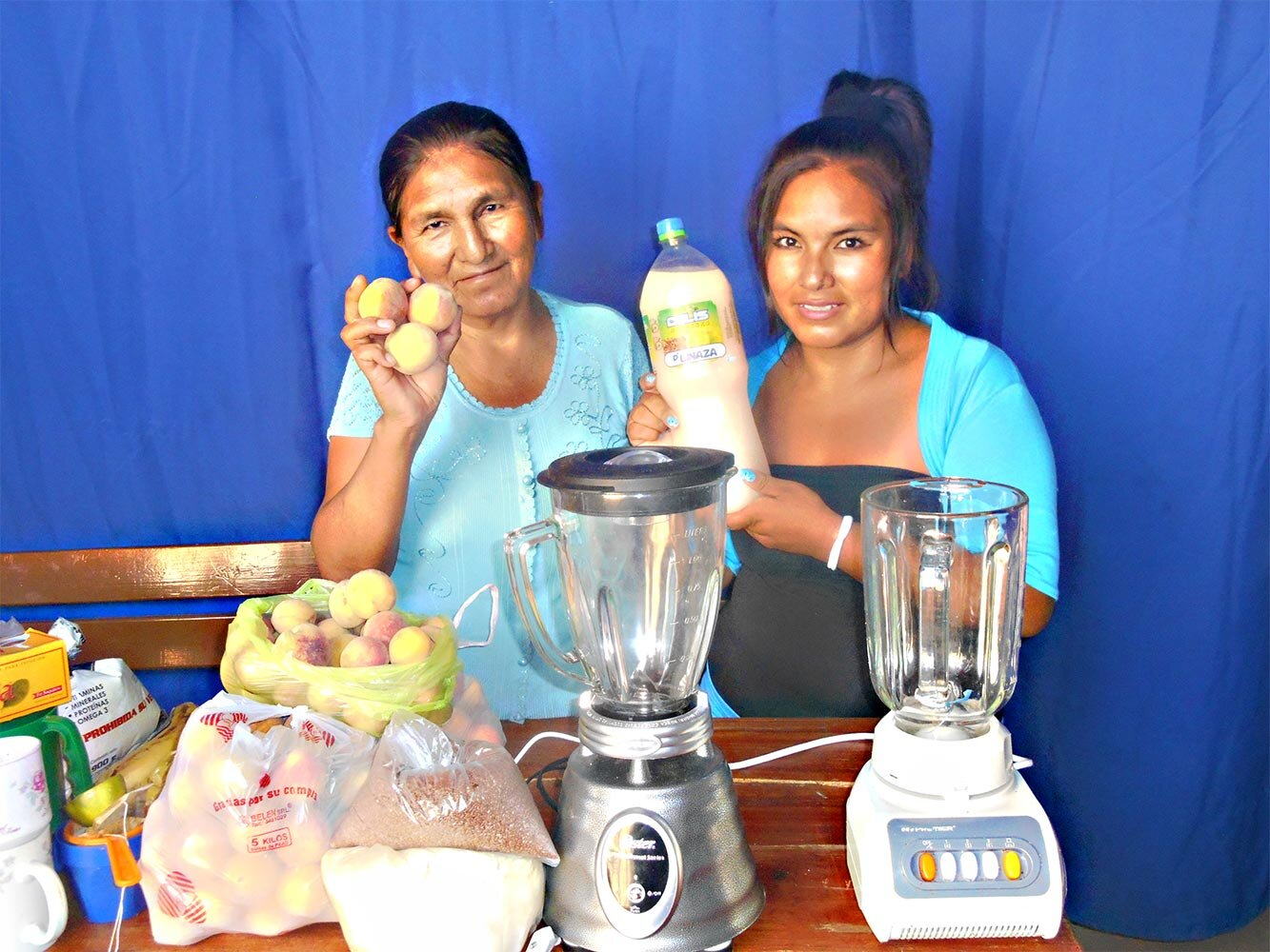Valentina and her daughter Esther show off their juice business in Bolivia.