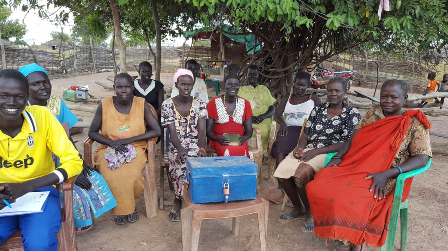 Above: Gondit and Regina with members of their savings group in South Sudan.