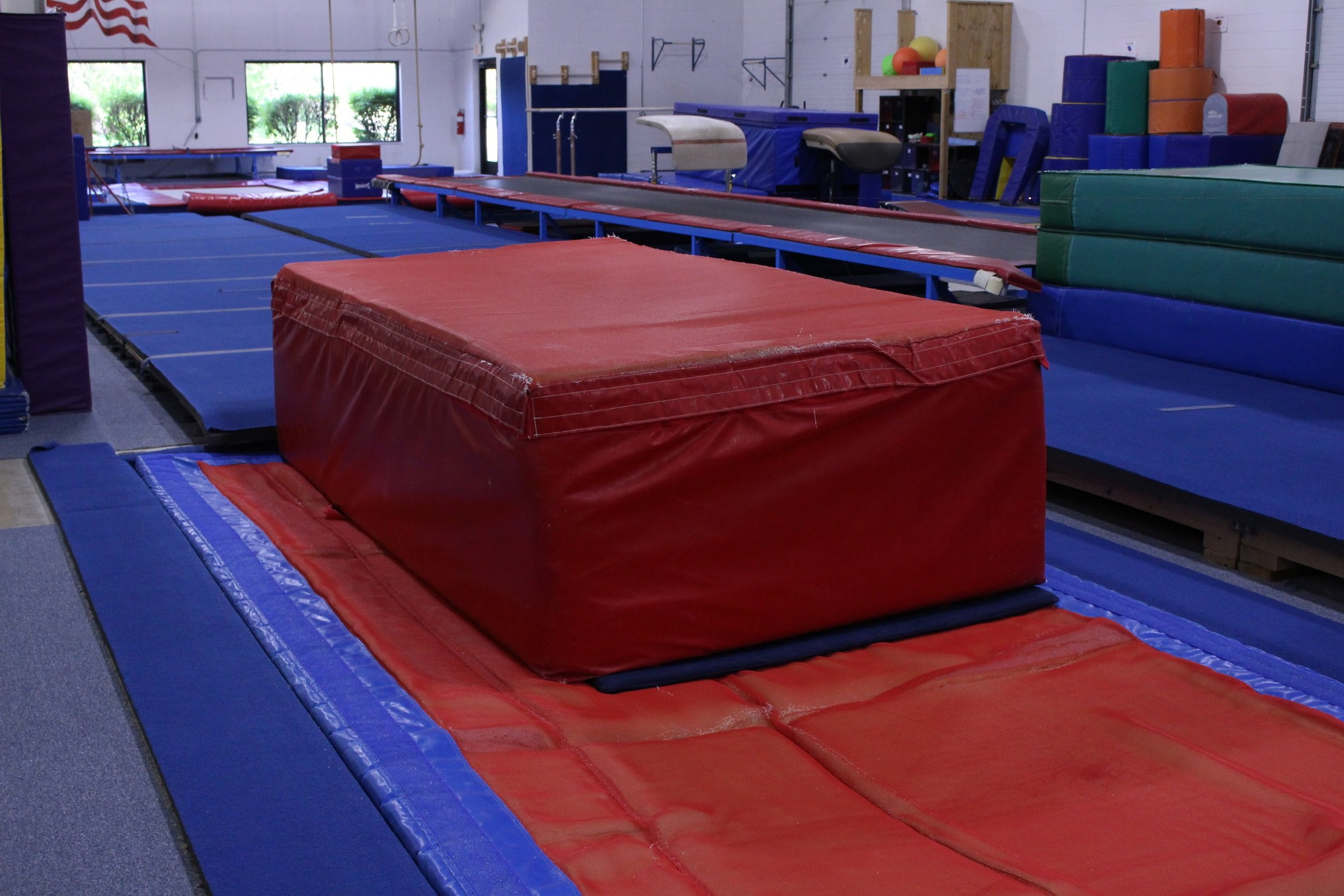 Recreational Classes - We offer noncompetitive gymnastics classes for beginners all the way to advanced gymnasts aged 6-18. Students' skills and movements are periodically tested to determine their appropriate class level and when they should advance. They learn skills on the spring floor, uneven bars, balance beam, and vault. They also use the Tumbl Trak and trampoline.Learn More →