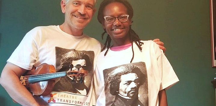 Dr. Amanda Kemp and husband Michael wearing their Frederick Douglass T-shirts.