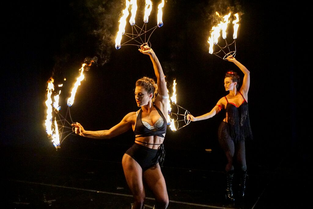 Shannon Corbeil and Anne-Marie Talmadge perform a fire fan duet. Image by Zach Davidson.