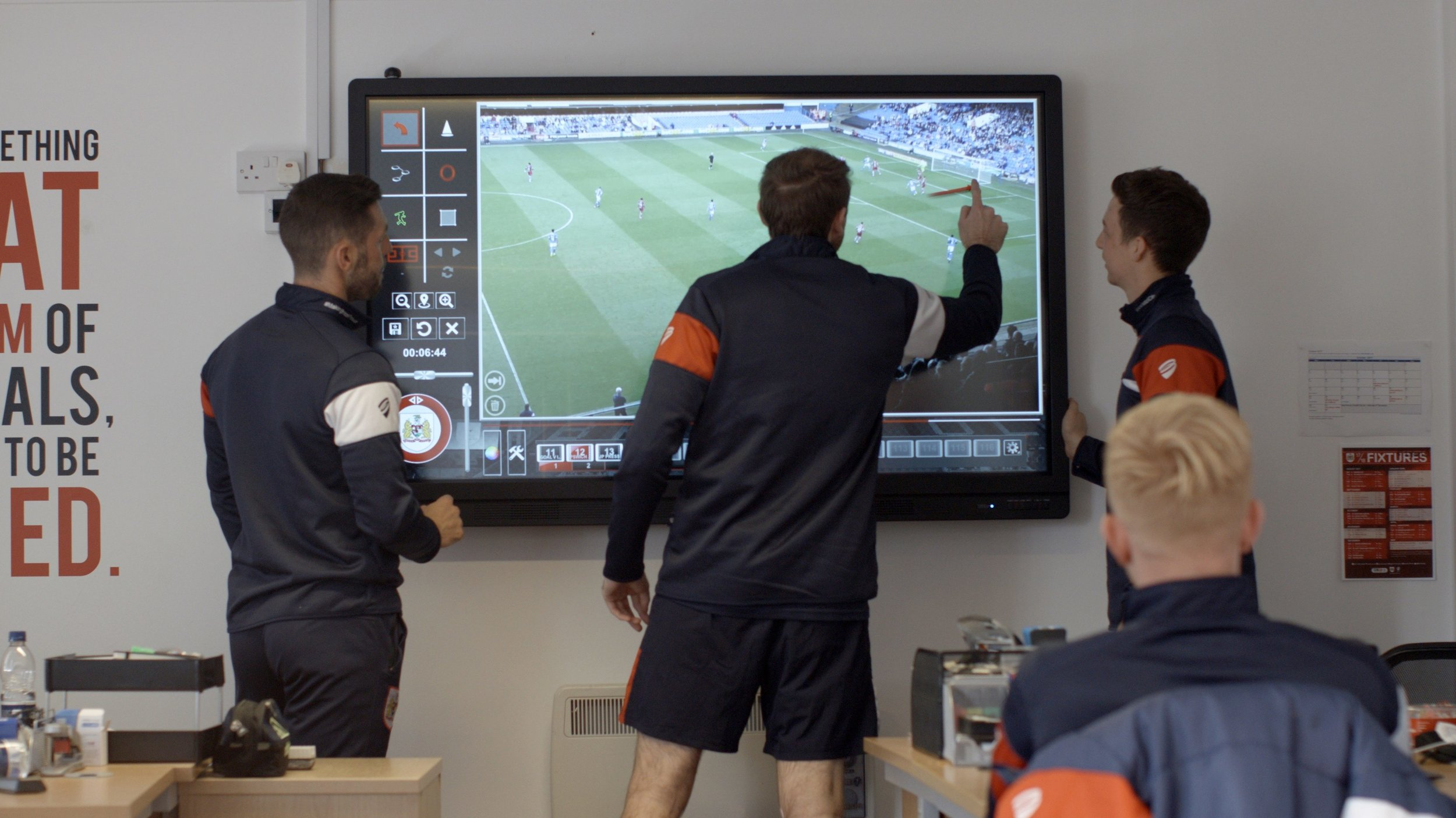 Coaches analyze and study game film to identify potential areas of improvement to their teams