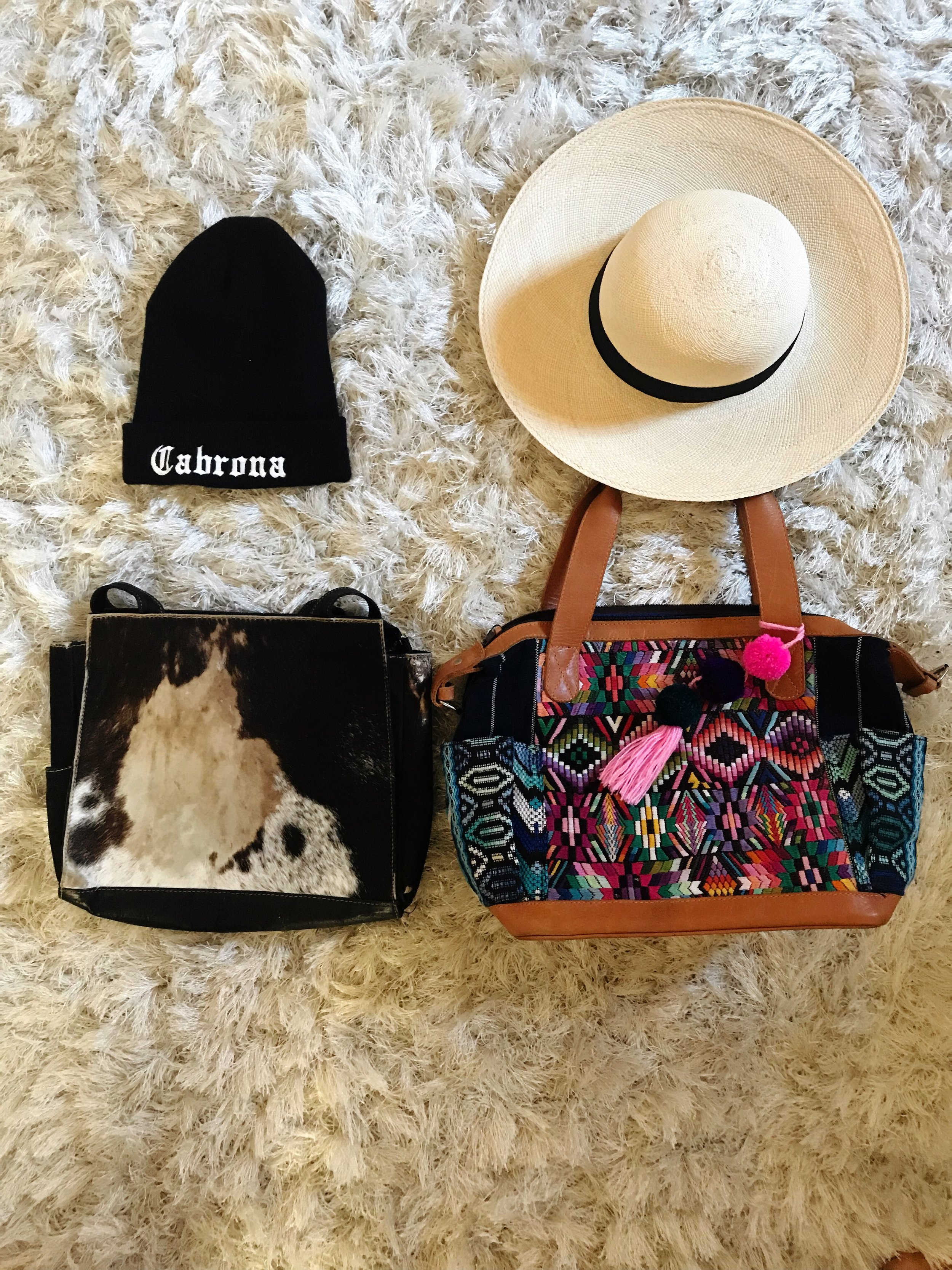 Hats from L to R:  Eldani Studio ,  Goorin Bros .   Bags: My mother's vintage cowhide purse from Colombia,  Hiptipico