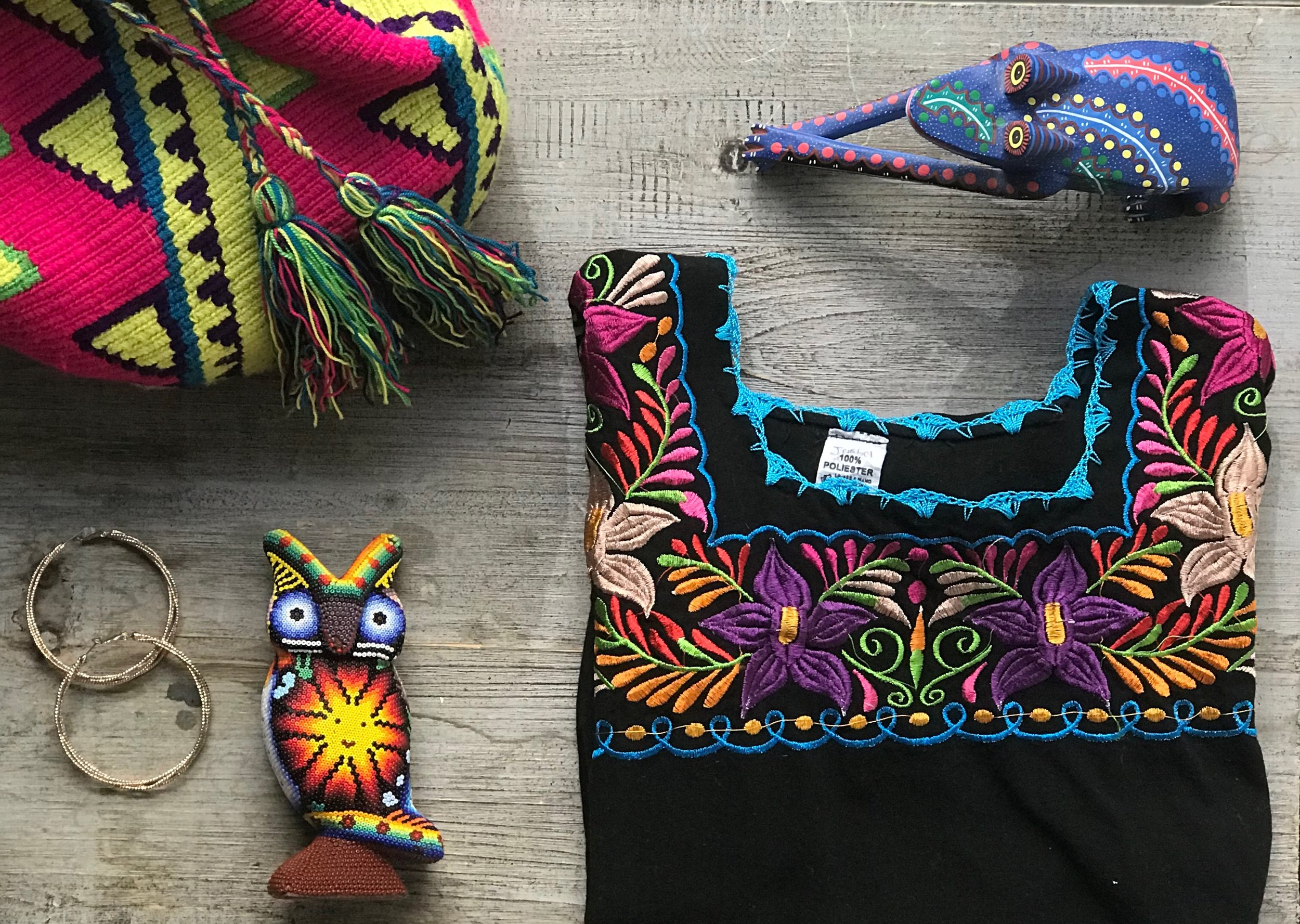 A purse made by the Indegeounous people of Northern Colombia, a Mexican hupil, large gold earrings. I consider this my resistance starter pack