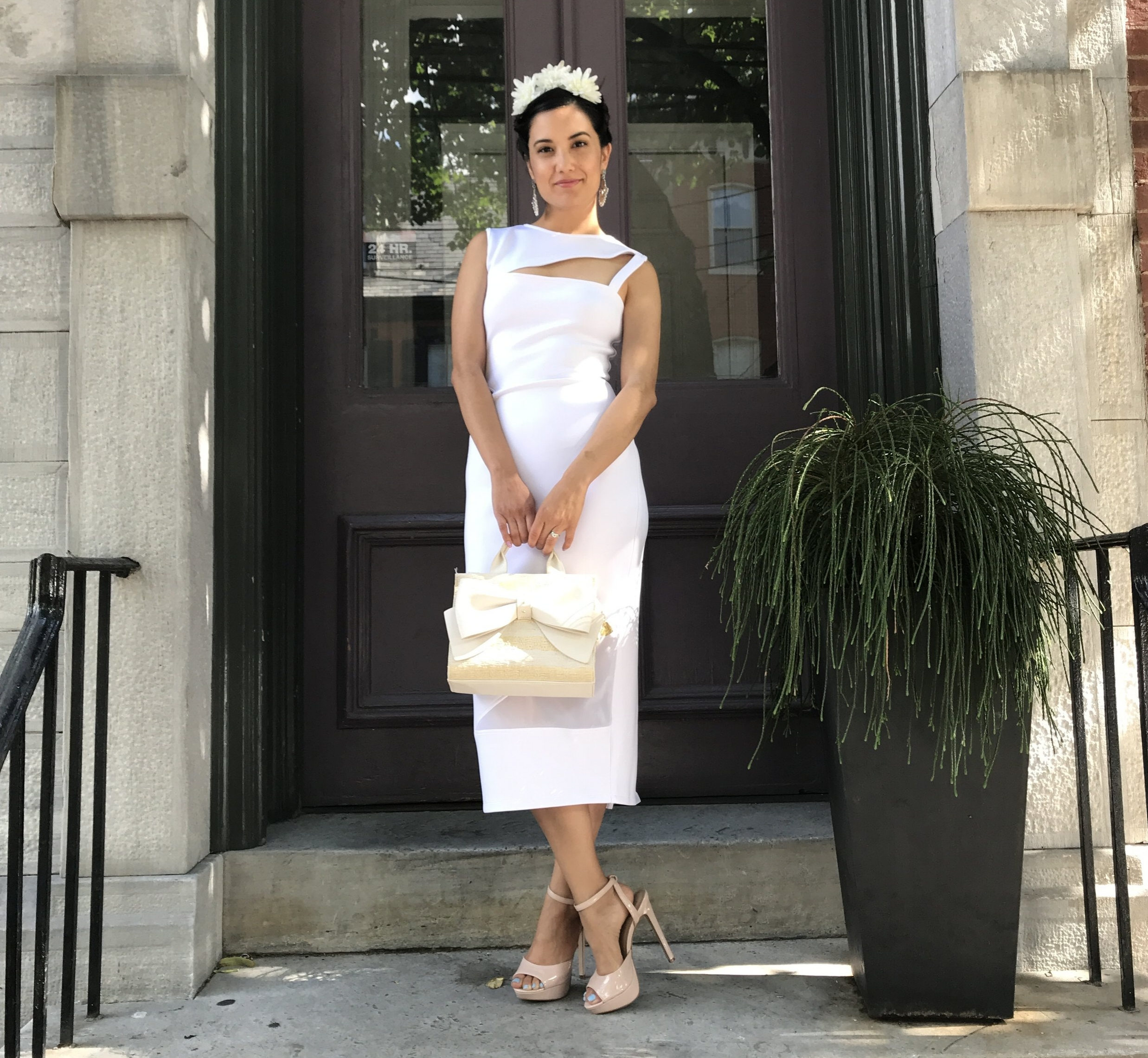 Ethical and low-waste dress borrowed from  19th Amendment  mixed with a second-hand purse and heels to show my commitment to ethical fashion and fair labor practices. I had to add the flowers on top in honor of the original radical fashionista Frida Khalo.