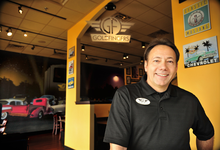 Goldfingers owner Bill Dorminy poses for a photo inside of the Goldfingers restaurant at Cottonwood Corners on Wednesday morning. Jay Hare / Dothan Eagle
