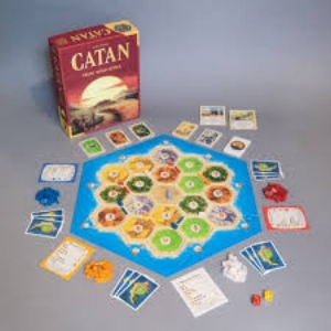 In   Catan   (formerly   The Settlers of Catan  ), players try to be the dominant force on the island of Catan by building settlements, cities, and roads. On each turn dice are rolled to determine what resources the island produces. Players collect these resources (cards)—wood, grain, brick, sheep, or stone—to build up their civilizations to get to 10 victory points and win the game. $49.99