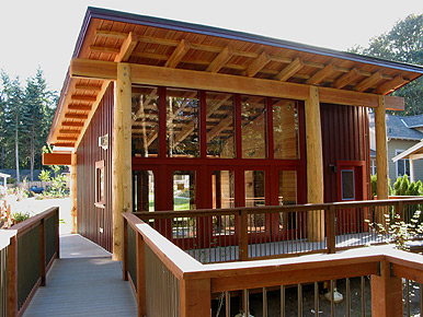 Common house with exercise room, dining area and terrace at   Conover Commons  in Redmond, Washington