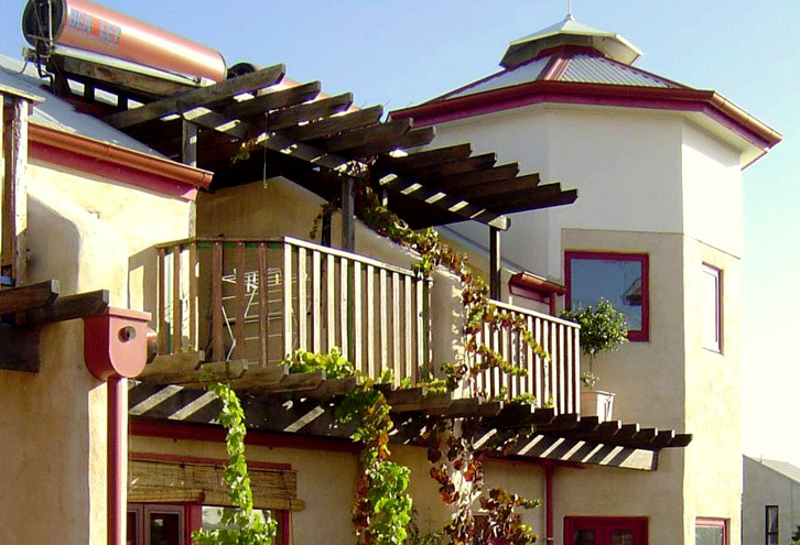 The vines climbing up to the balconies are not only meant to beautify, but also provide shade