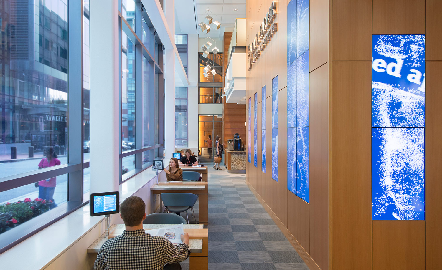 Interactive digital displays in the lobby showcase Dana-Farber Cancer Institute's research, mission and values.