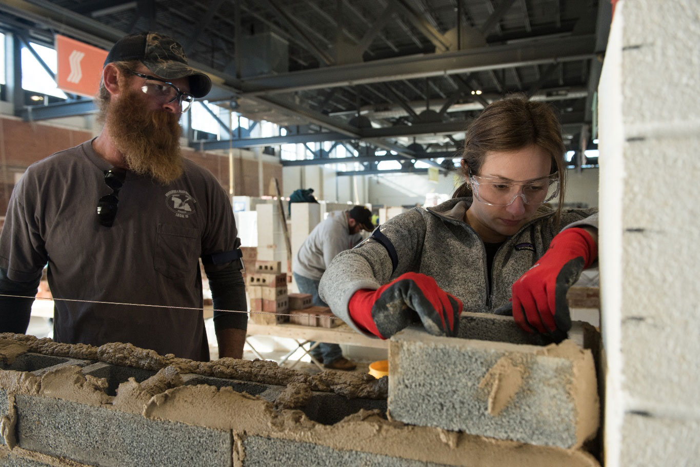 Kelsey Holmes (right) and Jason Bock of BAC Local 1 NB (left)in a hands-on block instruction
