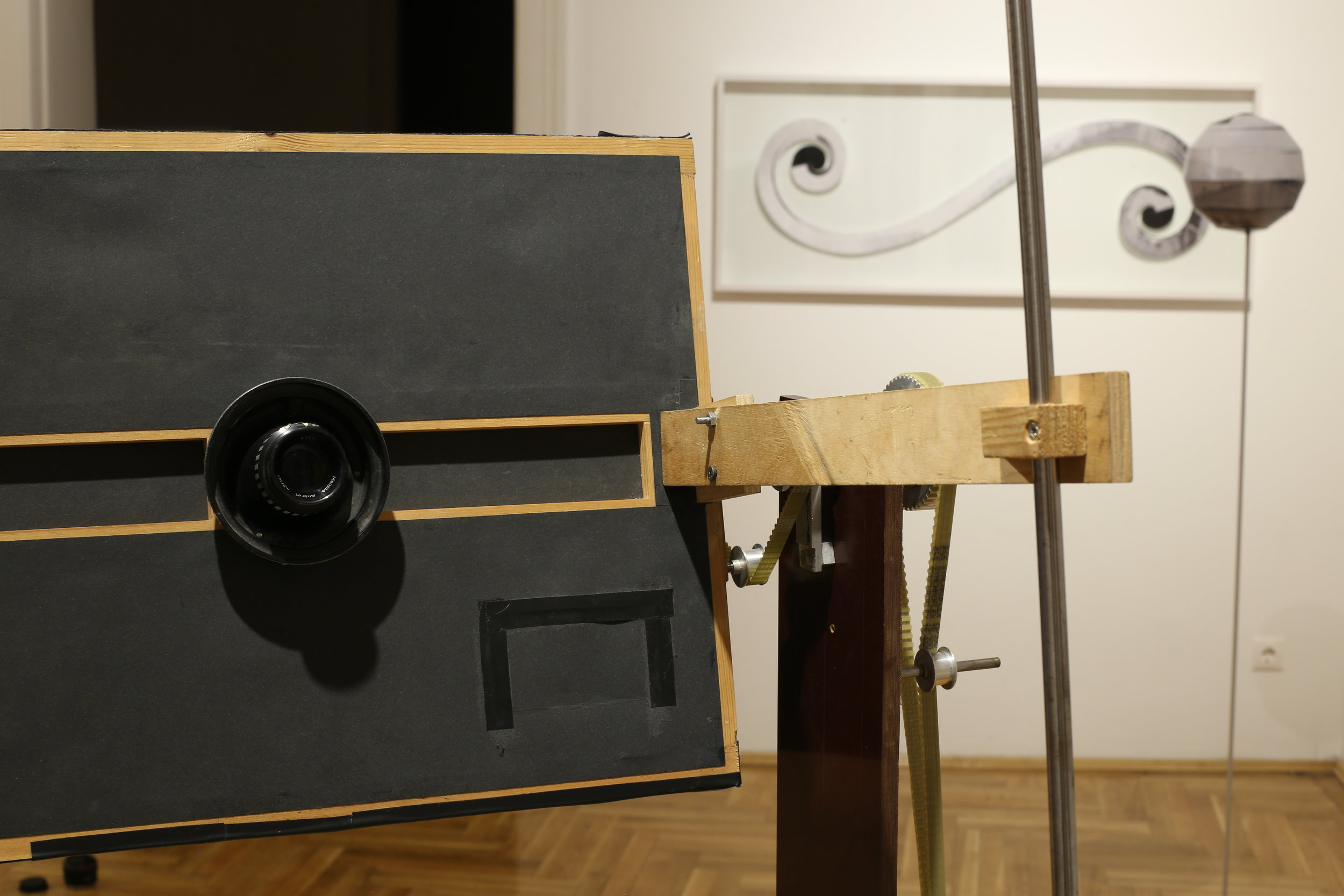 """View of the exhibition with the """"Orange Space Camera"""" fabricated by the artist."""
