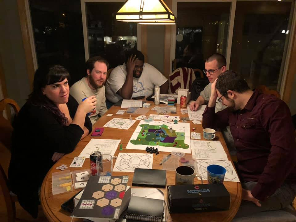 Brad Talton of Level 99 Games (right) is thinking hard about his choices here.