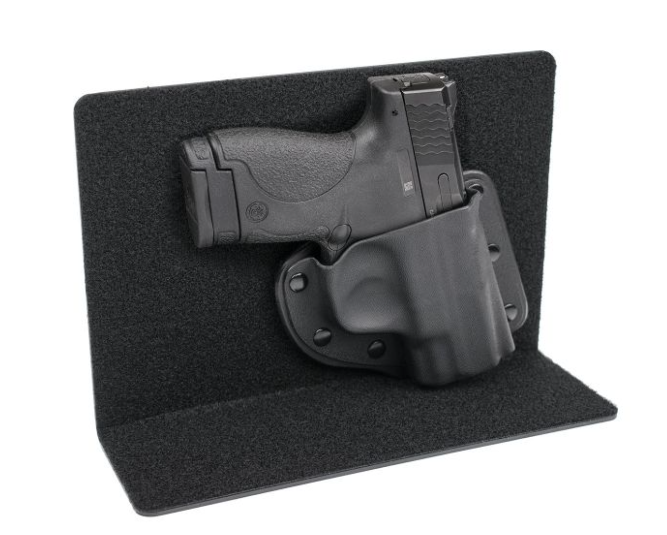 Purse Defender, Crossbreed Holsters, $52.95 - I realize this isn't a purse, but if you want to purse carry in a bag you already have -- this is an excellent option for you.  The Velcro-lined L-shaped Kydex panel fits securely in your purse, keeping your gun stabilized, and the handcrafted modular holsters fits a variety of small to medium-sized handguns.  For a complete list, click