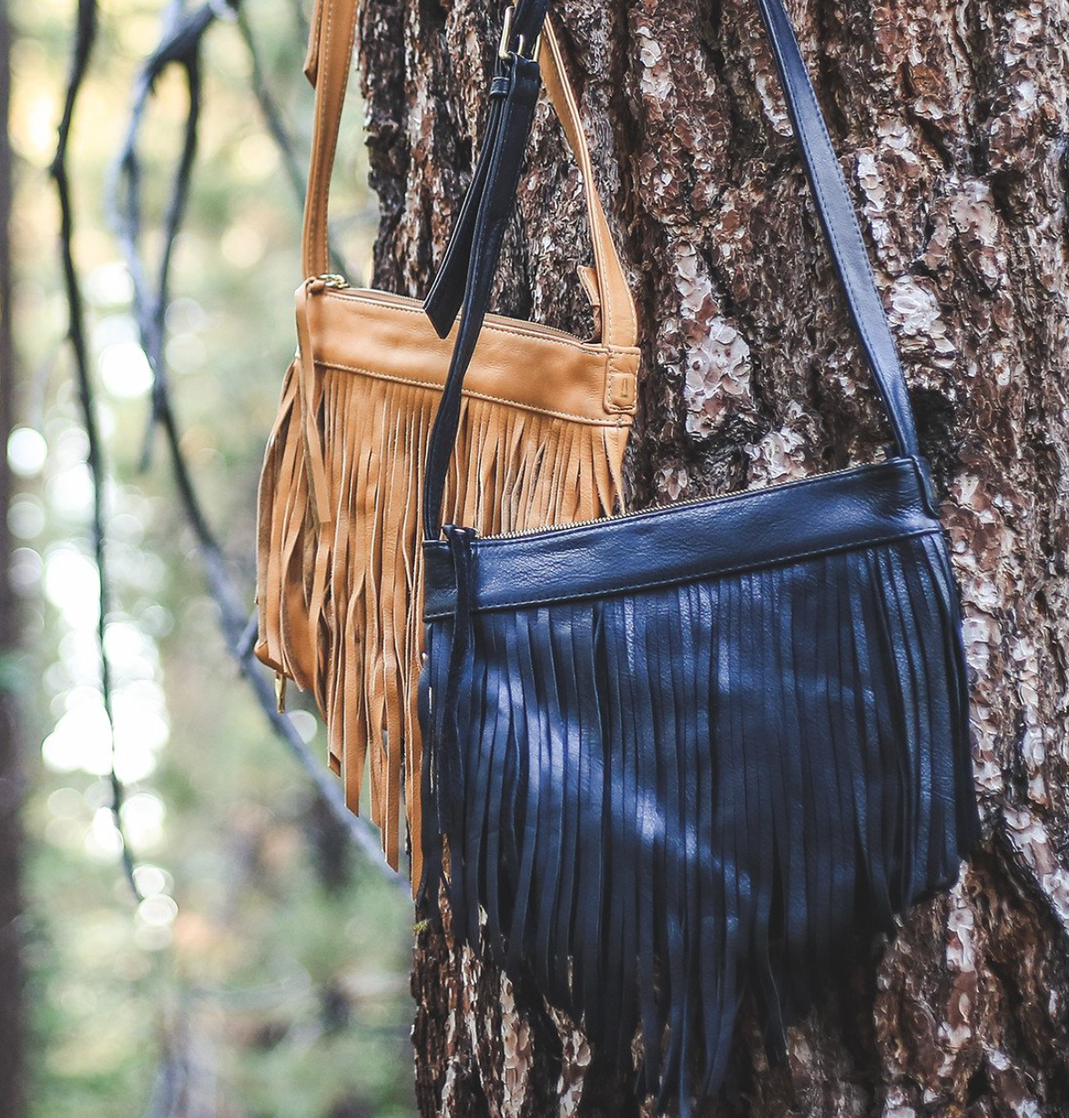 Taos Fringe Crossbody, Coronado Leather, $349 - In colors black, nude and saddle, this bohemian-chic bag is especially ideal for concealed carry because of its key-locking CCW zipper pocket and its ballistic Nylon lining.  Photo Credit: CoronodoLeather.com