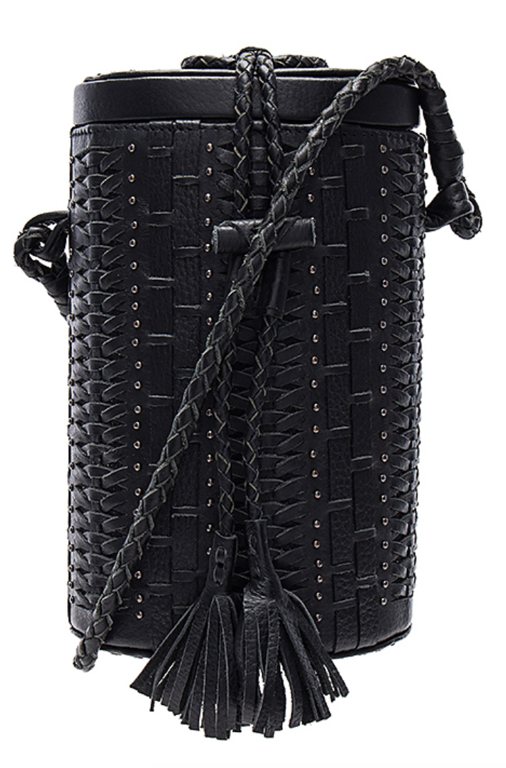 Crosstown Bucket, Cleobella, $132 (originally $249) - There is so much boho goodness in this bag. Black makes it versatile for a multitude of outfits, while the structured bucket shape is a cool juxtaposition to the bohemian leather braiding. This has your festival needs covered.Photo Credit: Revolve.com