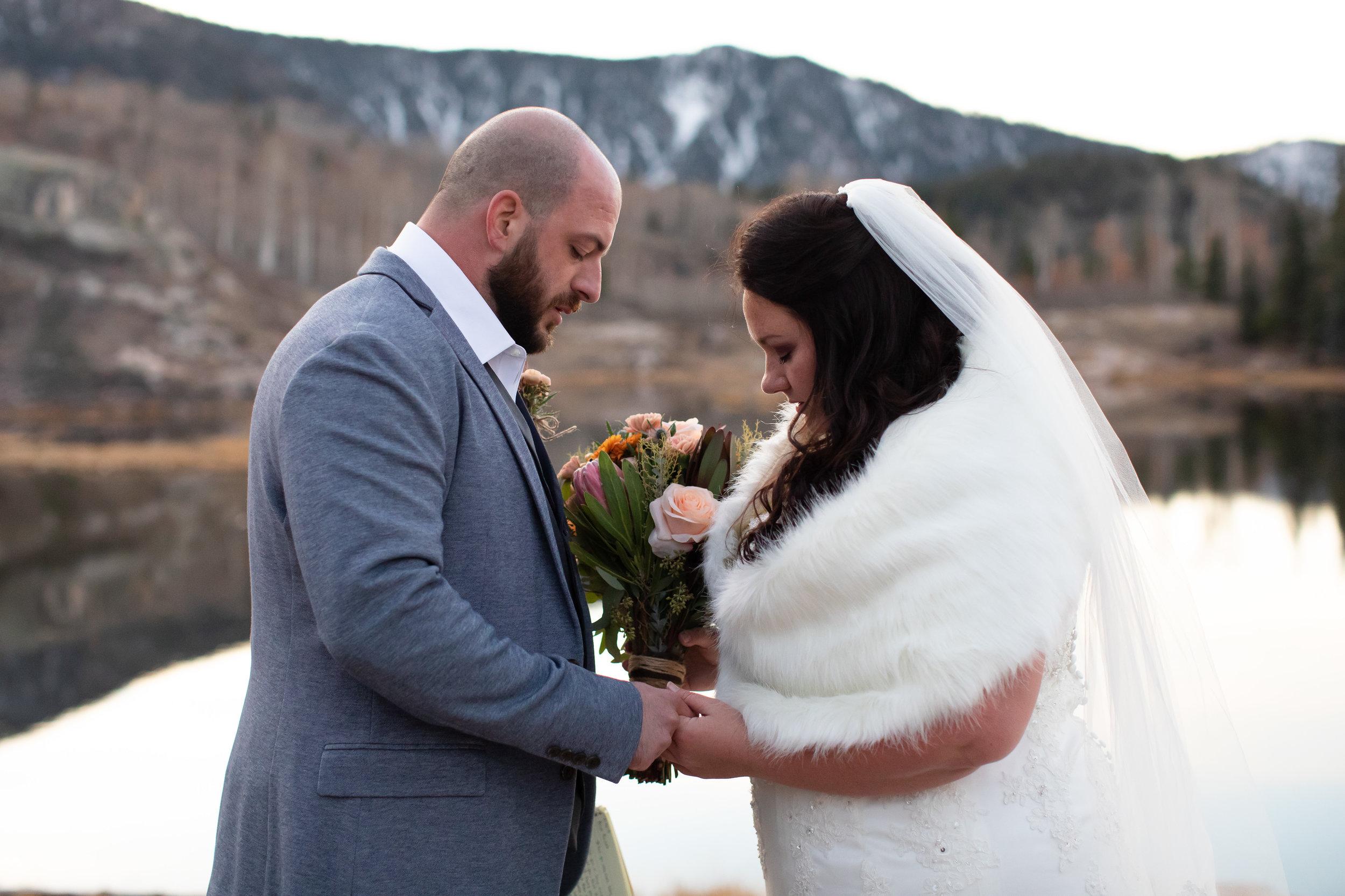 Praying during Durango, CO elopement