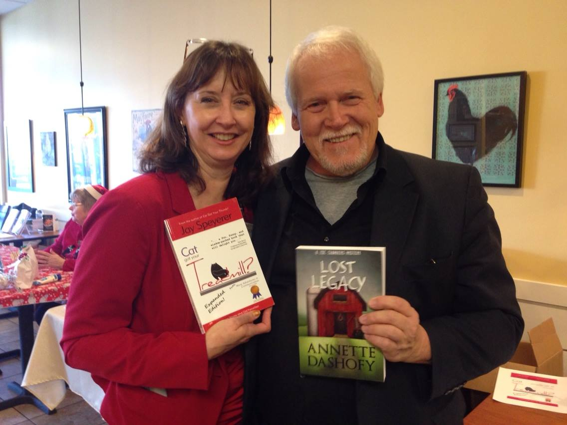 Jay with his friend and fellow author, Annette Dashofy exchanging books and laughs.