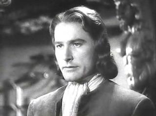 """""""Errol Flynn in Captain Blood."""" Picture is in the public domain because it was published between 1923 and 1977 without a copyright notice."""