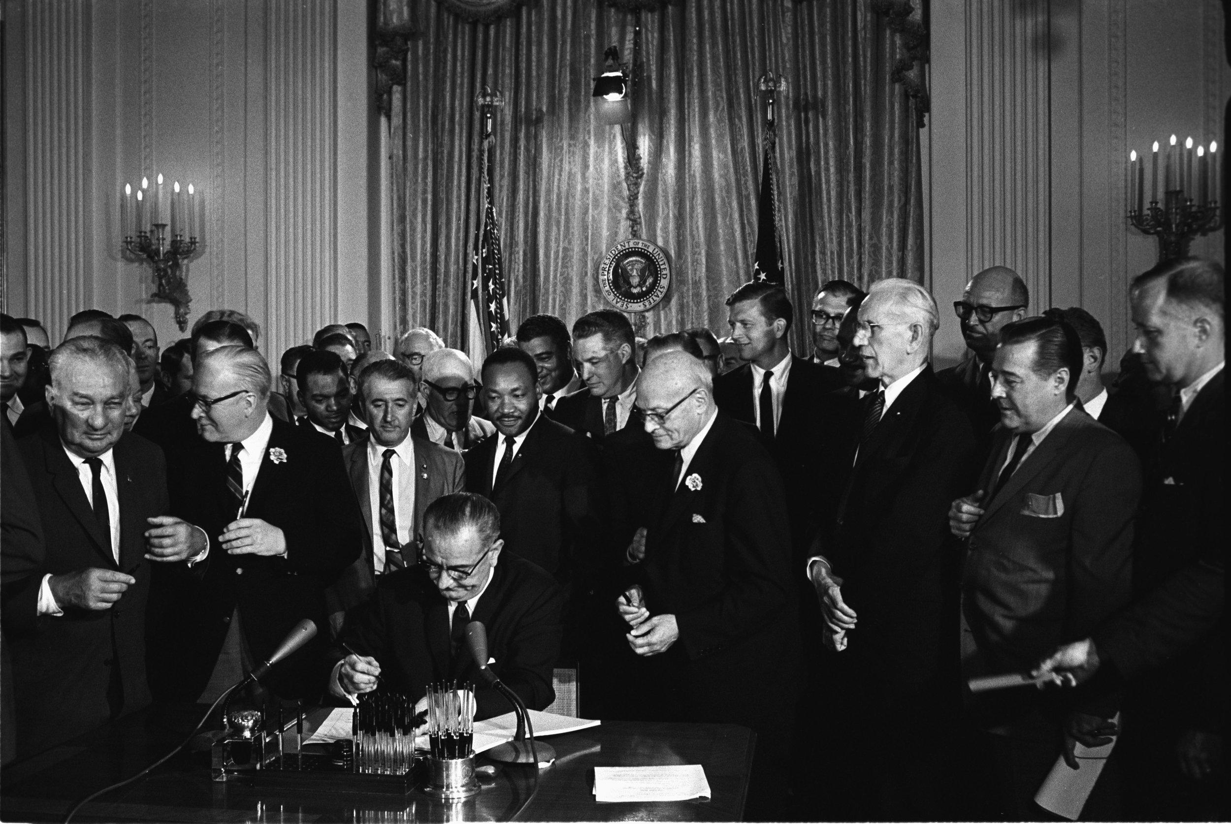 Lyndon_Johnson_signing_Civil_Rights_Act,_July_2,_1964.jpg