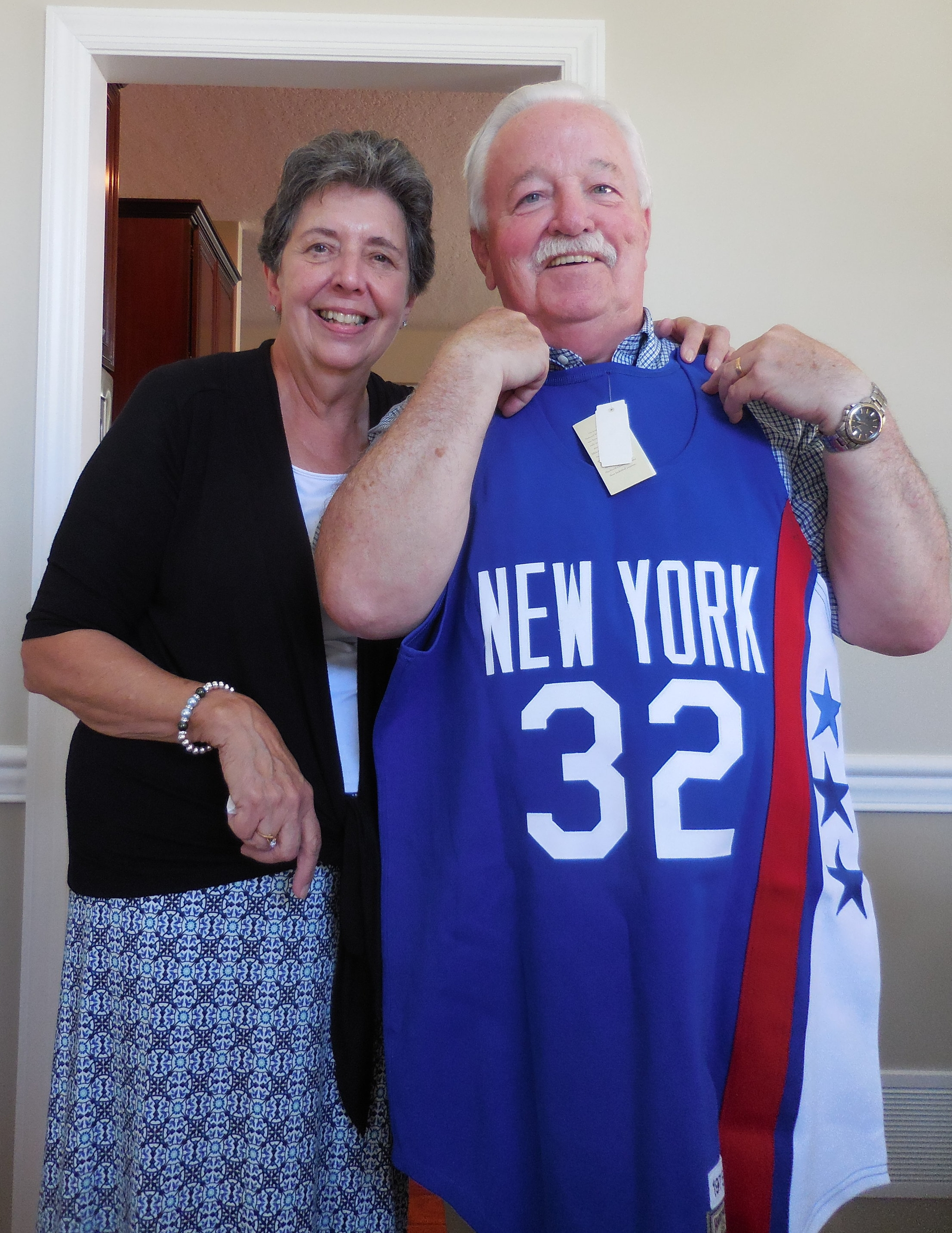 Kathie and Jim O'Brien with his beloved Dr. J jersey.