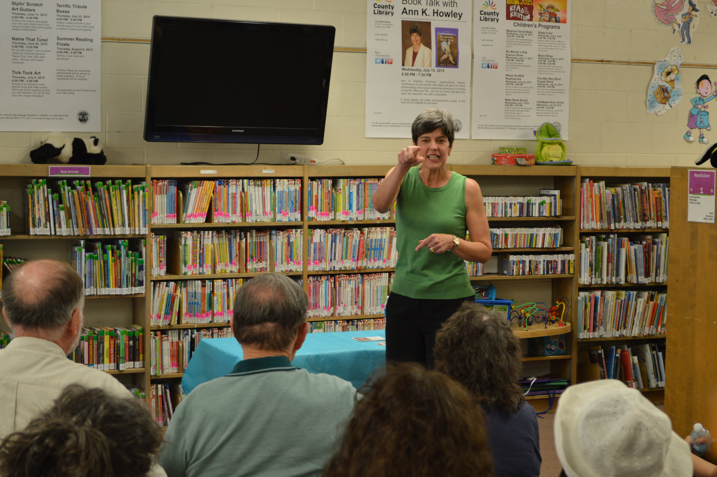 Ann Howley speaking at a library event in Los Angeles.