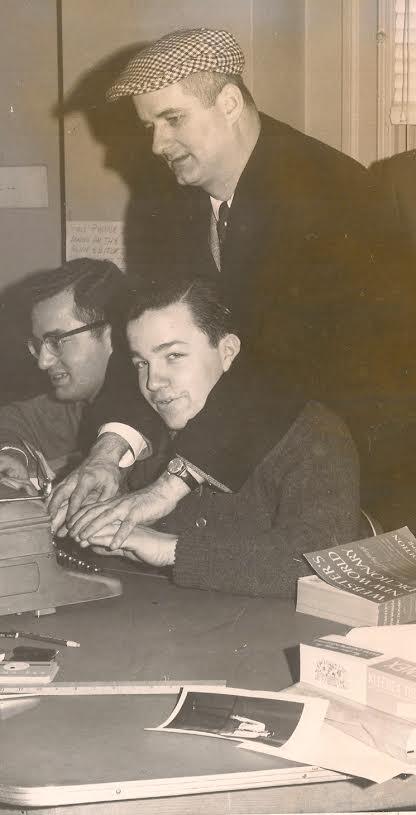 Pitt publicist Beano Cook helps Bob Smizik and Jim O'Brien, sports editors at The Pitt News in 1963.