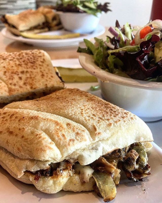 Our twist on the classic Steak Sandwich is served daily on a house pita roll with sautéed peppers, onions, mushrooms, American cheese, and our chive aioli. Roasted in our rotisserie then shaved thin-- just the way it should be.  #thecarrotco #fastcasual #explorerochester #iheartroc #rocny #victorny #eastviewmall #rochesterny #rocfoodies #rochestergrubhub #rochestervegan