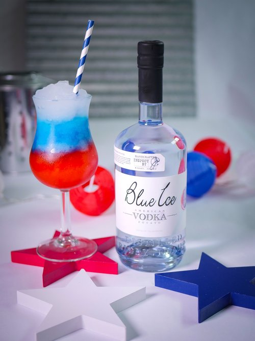 Red,white, and Blue Ice Lemonade Slush - Ingredients:· 9 cups ice (separated)· 1 cup grenadine syrup· 1 cup Blue Curacao· 1 cup Blue Ice Vodka· 1 cup LemonadeDirections:Add vodka, lemonade, and remaining 3 cups of ice to the blender and mix until slushy. It's not as important for this layer to be thick, but it should be comparable to the others. Add up to 1 more cup of ice if needed. When finished, set aside. Repeat steps for Grenadine and Blue Curacao. Layer all there flavors.