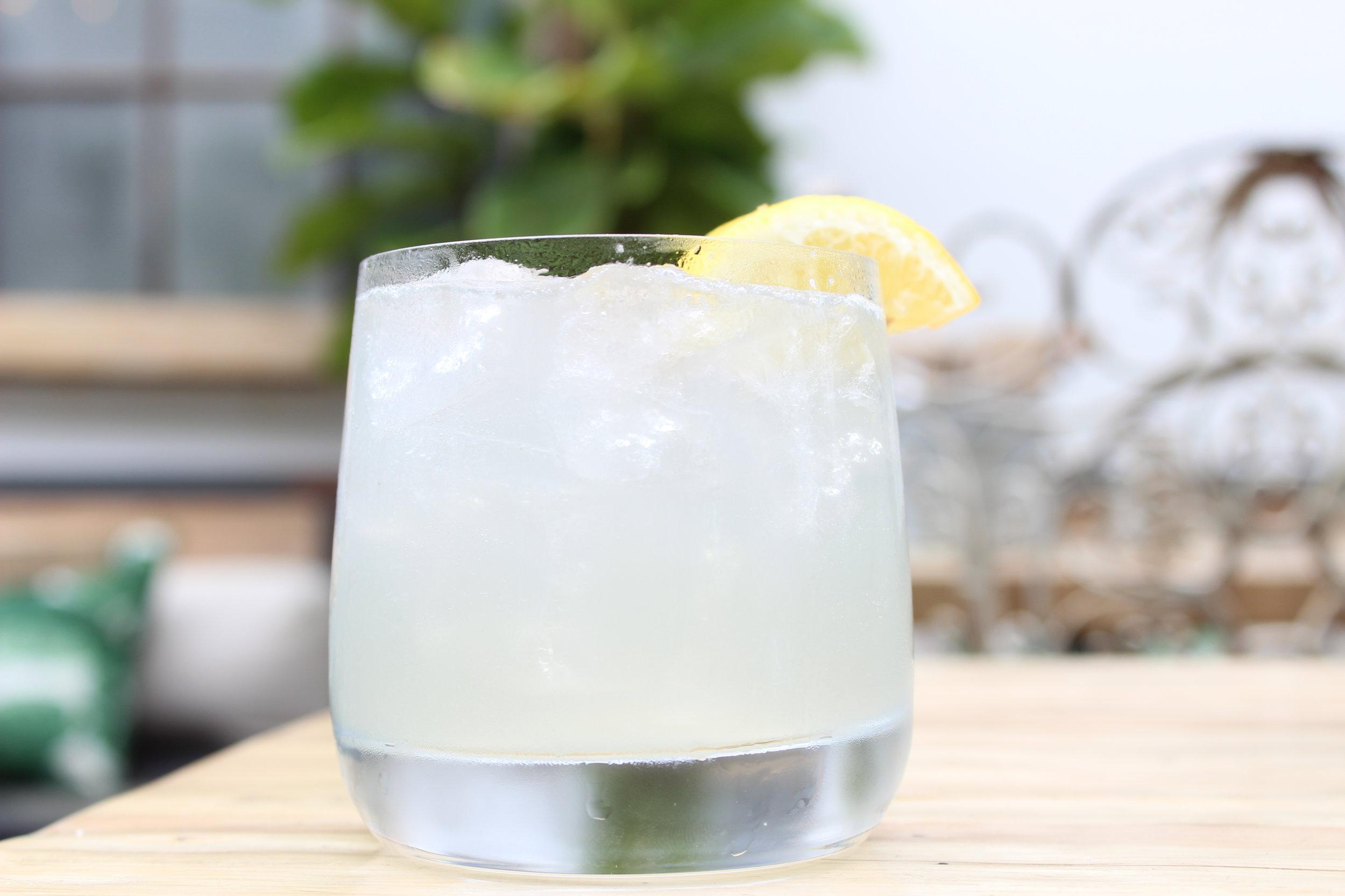 Midnight Grove - -2oz Charcoal Lemonade-1.5oz Blue Ice Vodka-1oz Lemon Grass Syrup-Shaken with Ice-Strained over ice in Rocks Glass-Garnish—Lemon Wheel