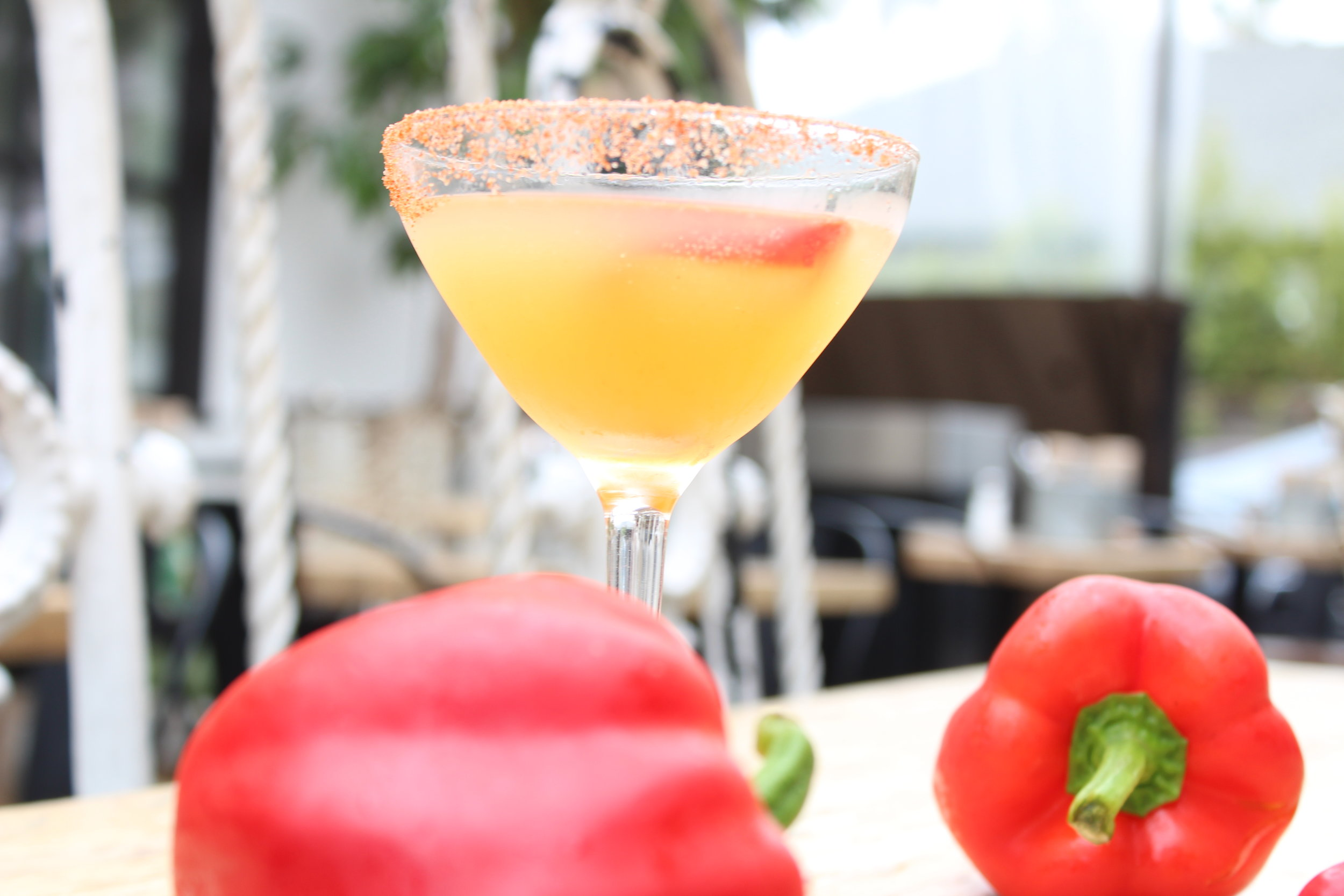 Pepper Paradise  - -1/2 Red Bell Pepper-1/4 Yellow Bell Pepper- 2 Yellow Beets- ½ Garlic Clove- 1.5oz Blue Ice Vodka-1oz Lime-1oz Agave