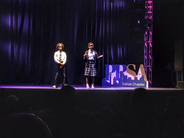 """Qaadir Abdul-Alim Muhammad & Megan Manning, 6th grade students at St. Phillip's School & Community Center share """"The Power of the St. Phillip's Creed in Our Lives"""" at the 2016 PRSA Dallas UnSummit."""