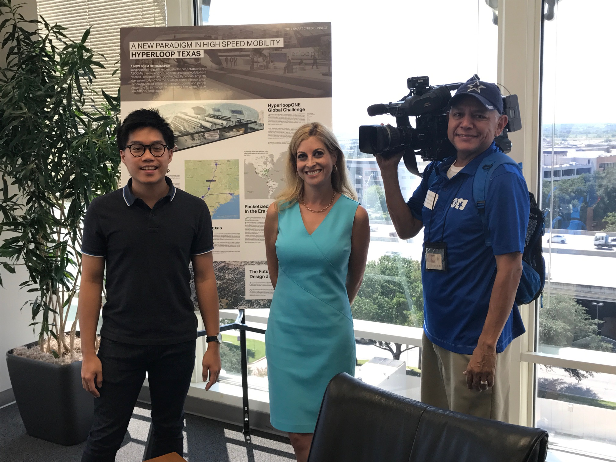 AECOM's Steven Duong poses with the CBS 11 crew