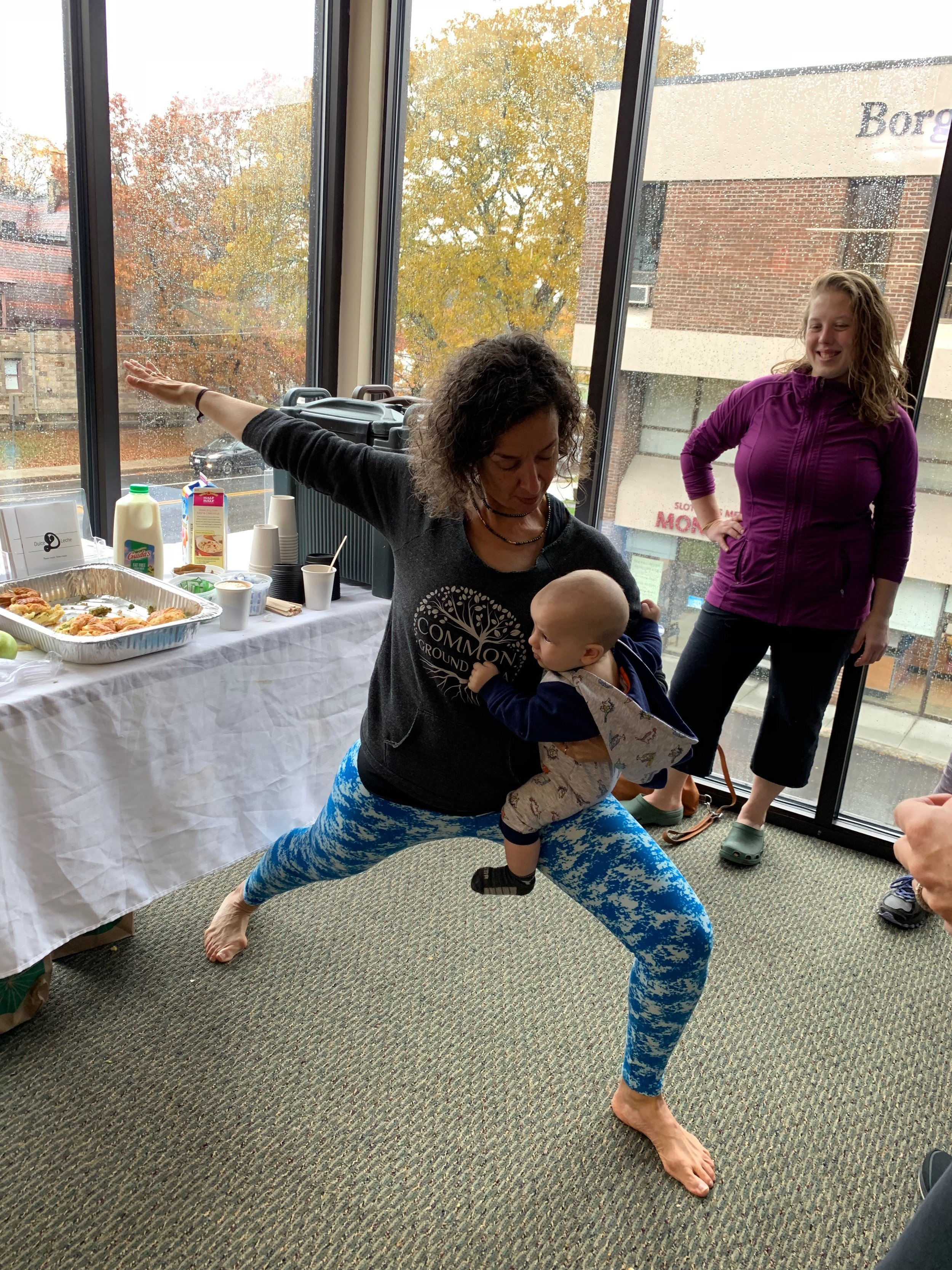 Carrie doing yoga with baby Sawyer at CGY's Fall 2018 Open House