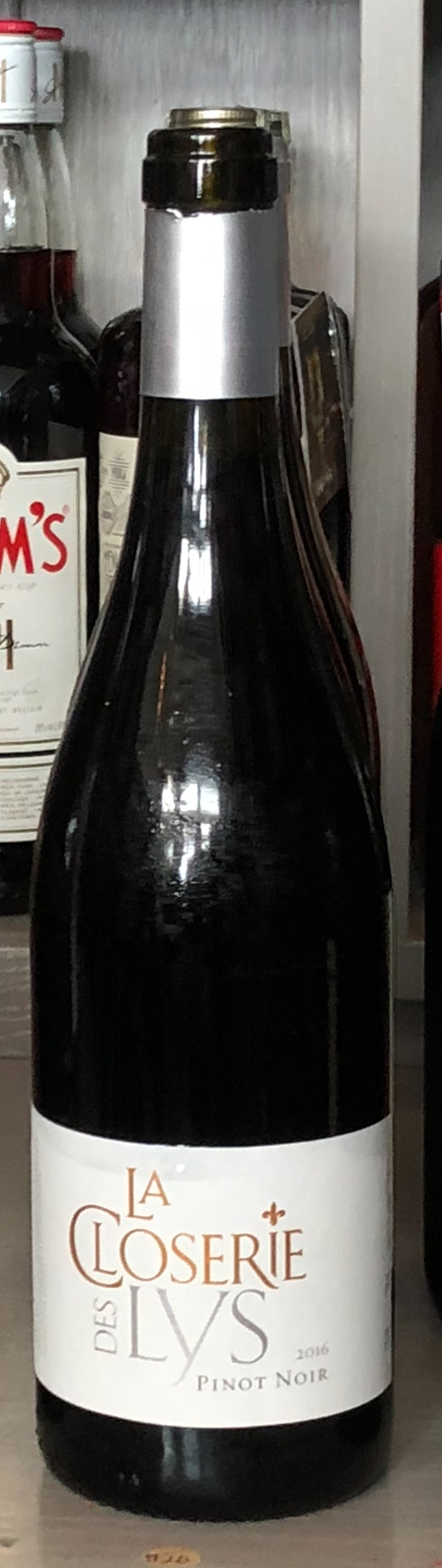 La Closerie des Lys Pinot Noir - This fruity, medium-bodied Pinot Noir with a nose of black cherry and spice comes from the Languedoc region of southern France. It is best served slightly chilled and we think it would make a great base for a summer sangria. $20