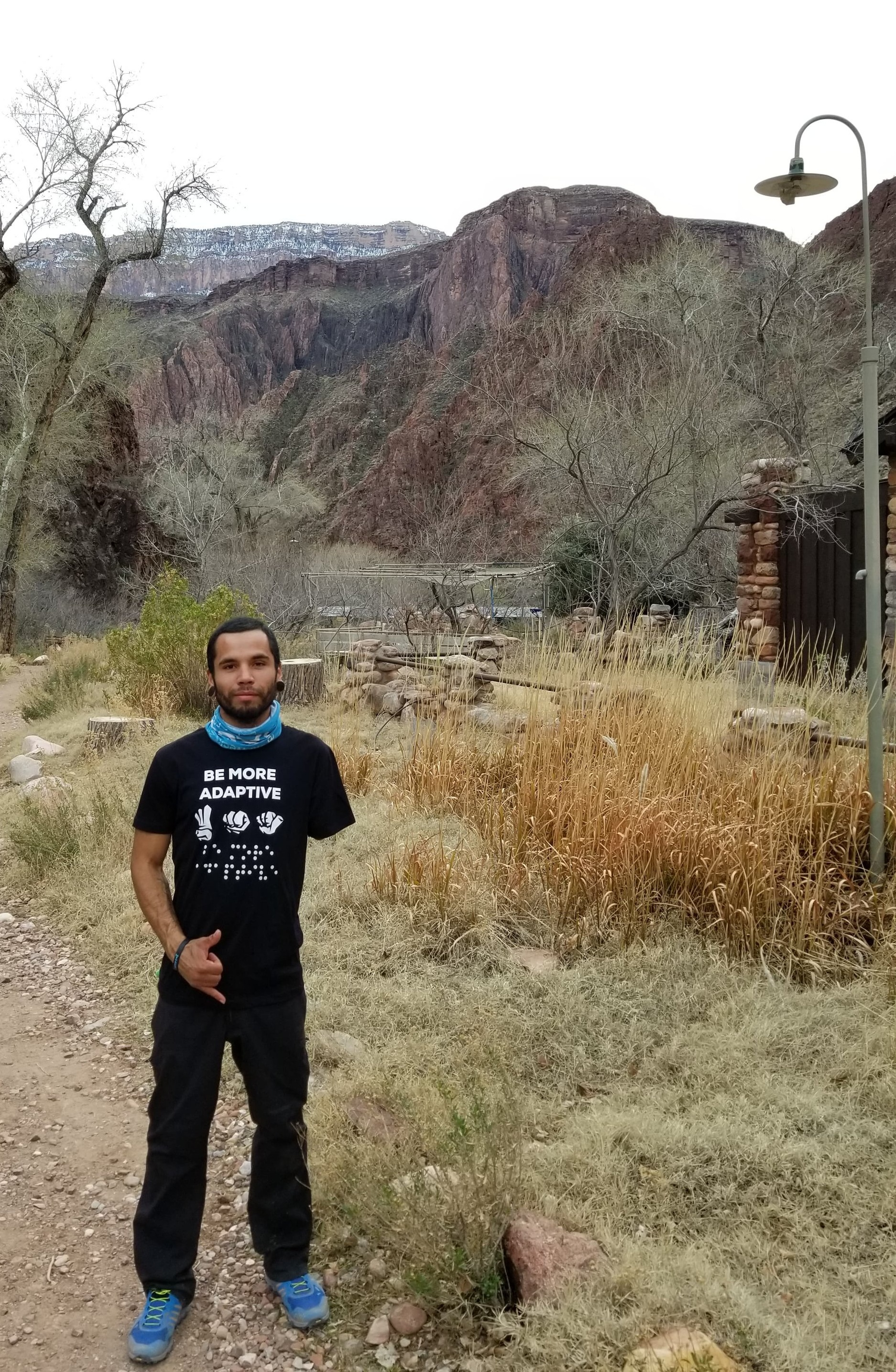 Jeremy Ogle is wearing a Be More Adaptive shirt while he hikes in the Grand Canyon.