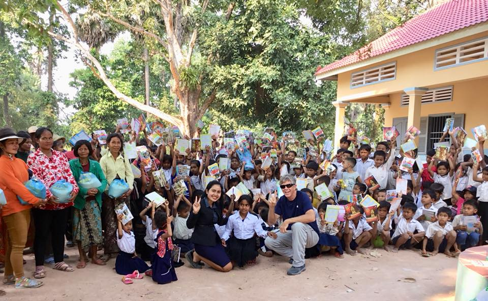 Distributing School Supplies To Students In Samrong