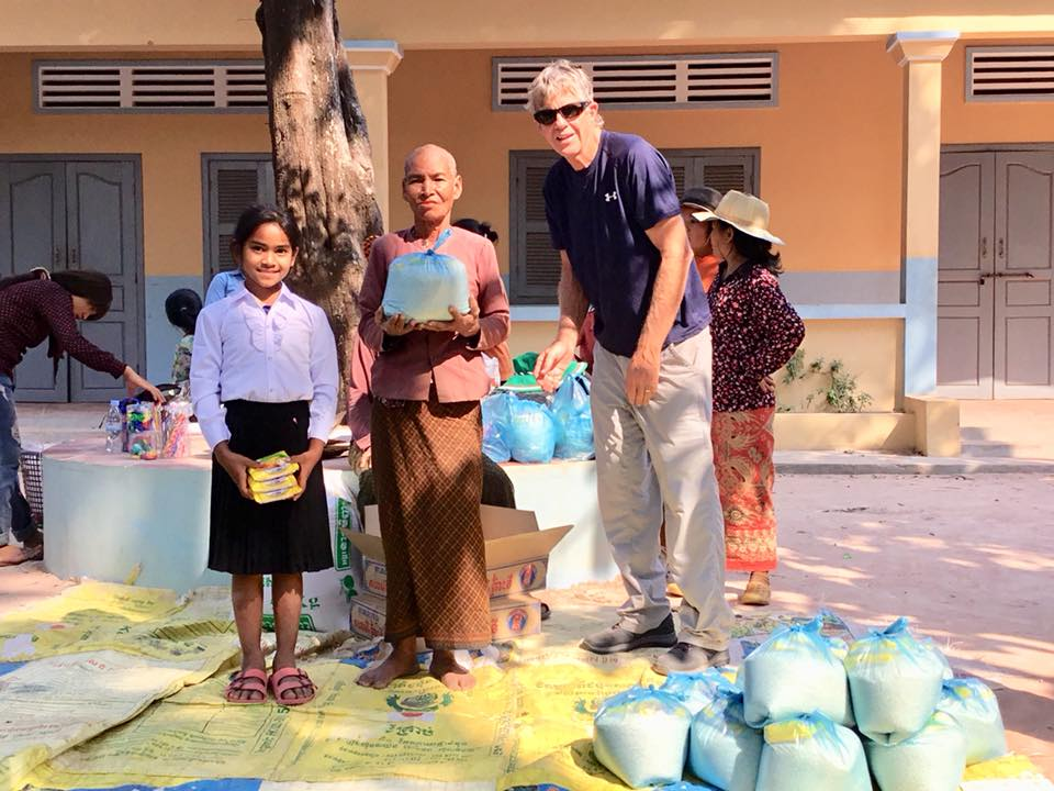Handing Out Rice In A Rural Village