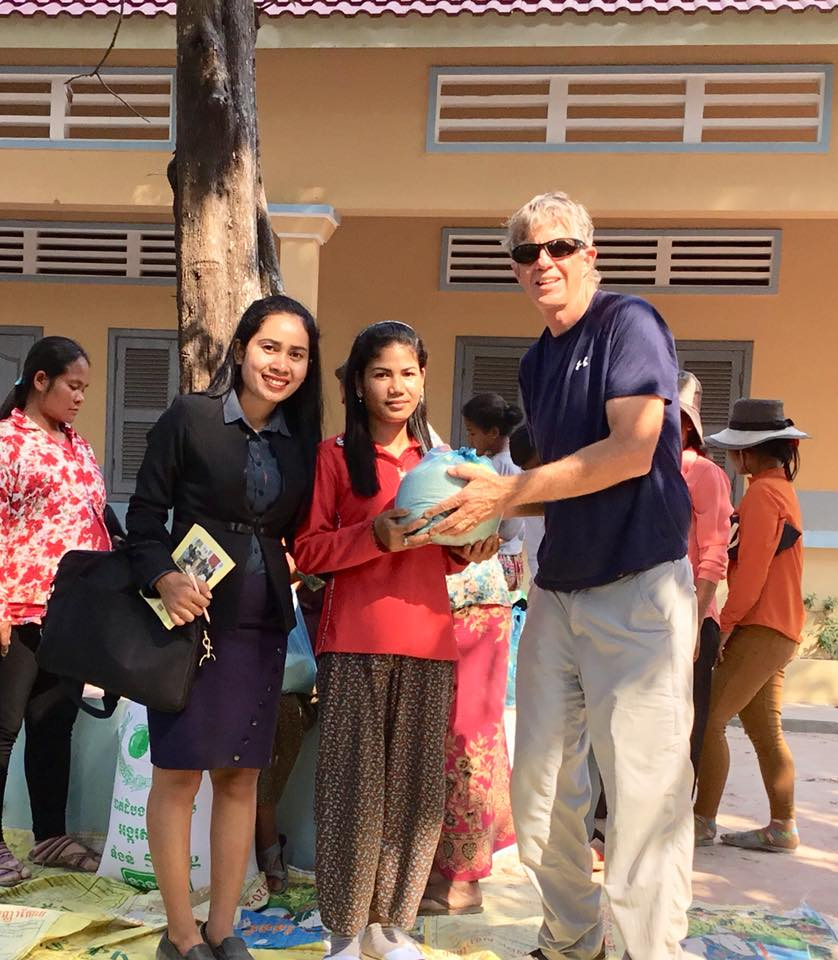 Handing Out Bags of Rice With Sa, One Of Our College Graduates