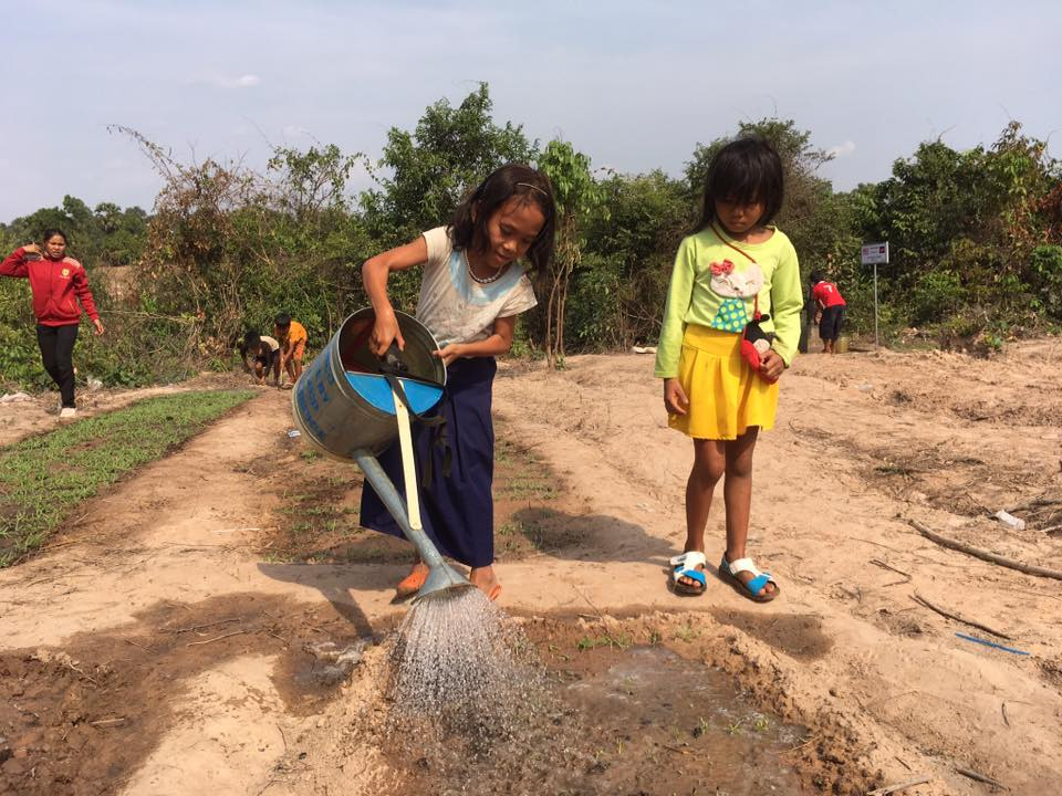 Tending The Garden With Water From Our Well
