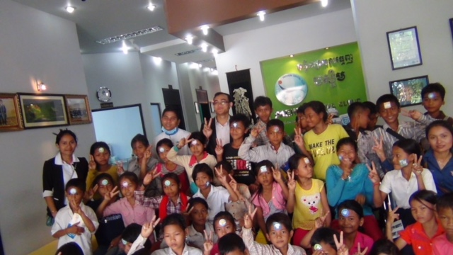 Taking a group of 50 children from a rural village to the dentist