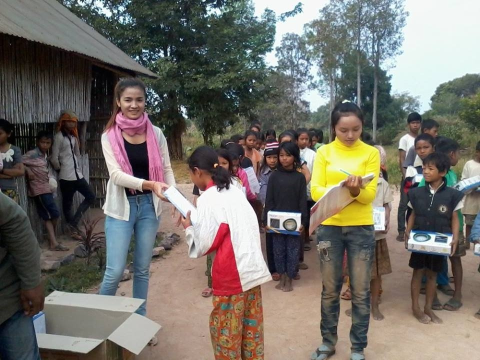 Handing out solar lights in 2015
