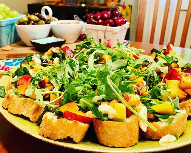 Nectarine caprice on bruschetta with fresh arugula and balsamic reduction. It's a thing and it's GOOD. So good! #foxgloveeventspdx #peachseason