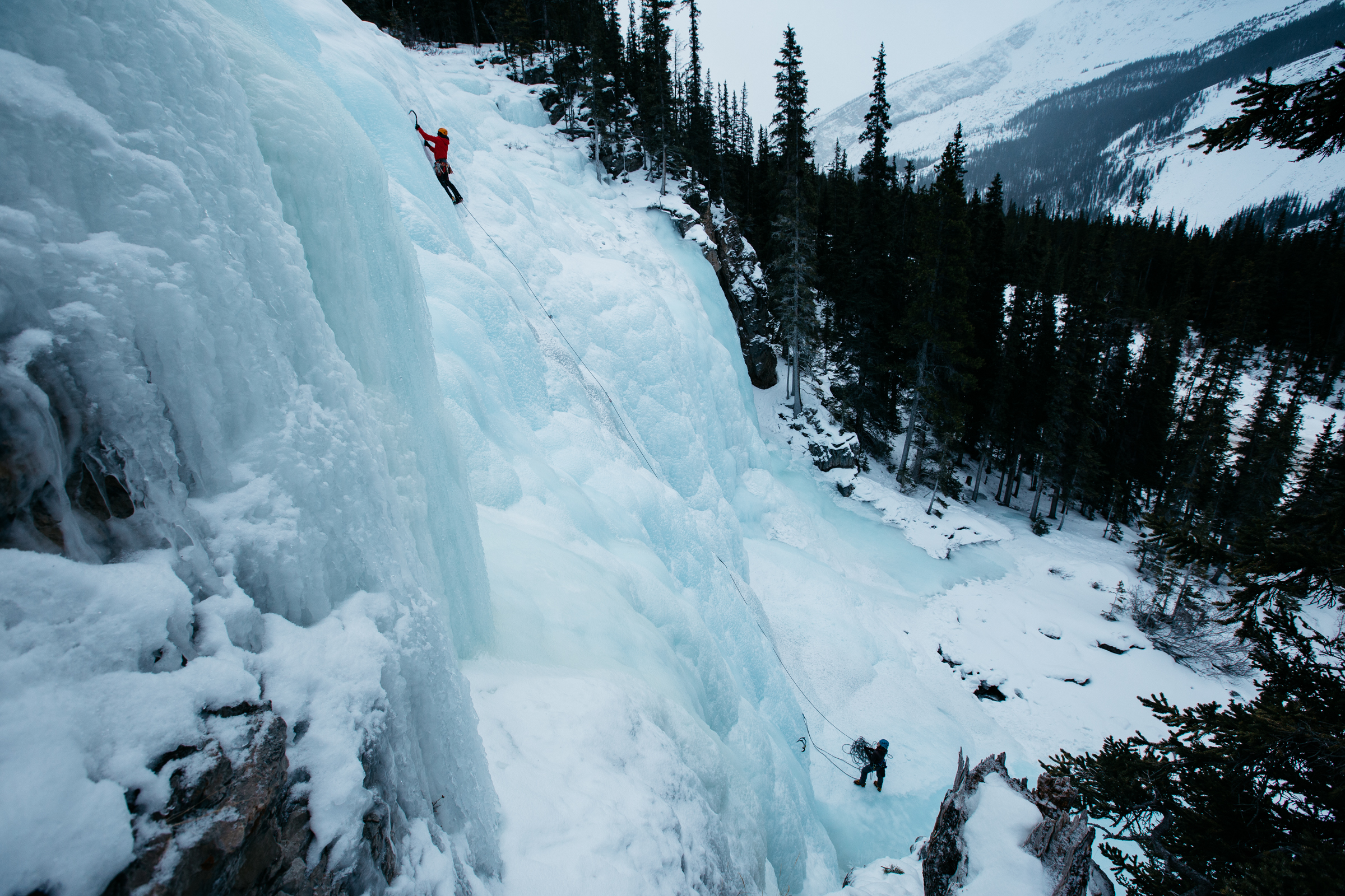 taken for the Mountaineer Inn in Lake Louise. We found this great climbing spot on the beautiful Jasper to Banff highway. This shot required Thomas to hike up steep, icy terrain without proper gear, but it was totally worth it!
