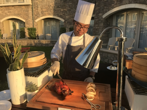 The sunsets at the Ritz Carlton Half Moon Bay are legendary, and the only thing that could make them better is this Peking duck carving station!