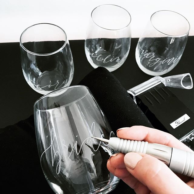 Calligraphy isn't limited to paper. I can also hand engrave my lettering on glass, metal, plastic, and stone. Here are some stemless wine glasses I've engraved this week. They make great bridal party gifts, or party favors. And can be used as place cards for dinners. I'm available to engrave on location for holiday open houses, wine tastings, charity events, and corporate brand activations. Traditional script style is available as well as this modern style.  #engraving #calligraphyengraving #onsitecalligraphy #livecalligraphy #alabamacalligrapher #birminghamcalligrapher #gracecalligraphy